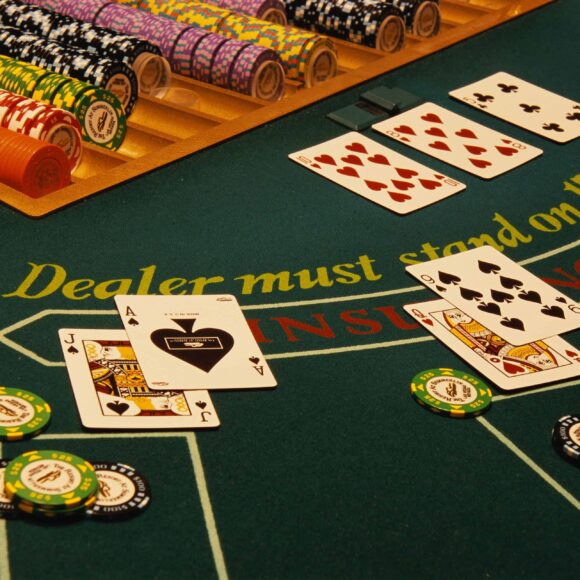 blackjack table with cards and chips on it