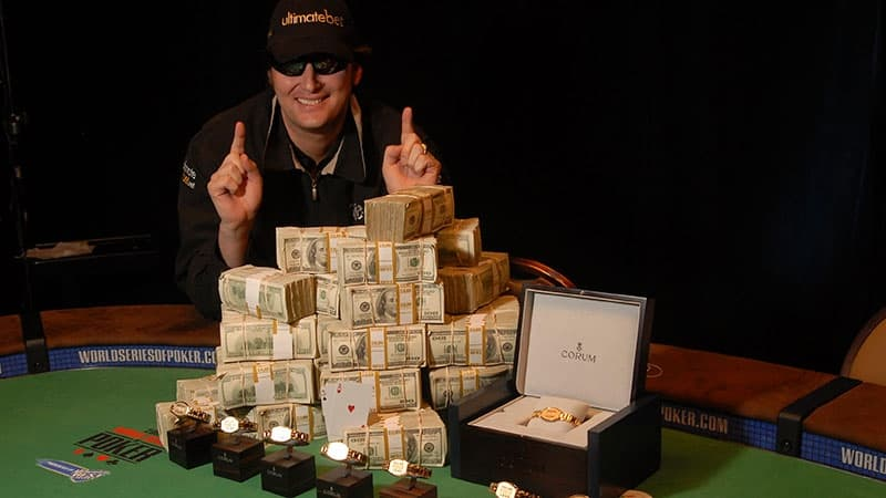 phil hellmuth with the wsop bracelet and the won money