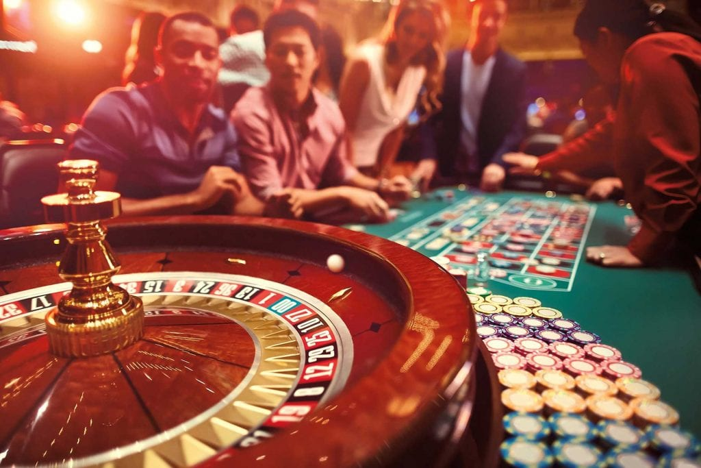 People around a roulette table